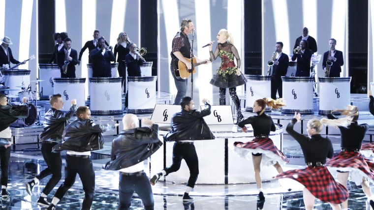 "Blake Shelton and Gwen Stefani singing a duet on ""The Voice"""