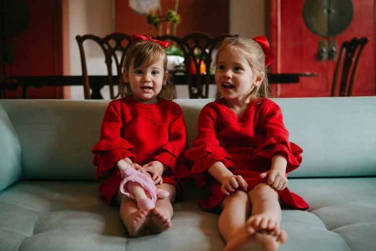 Love the matching red dresses and bows!