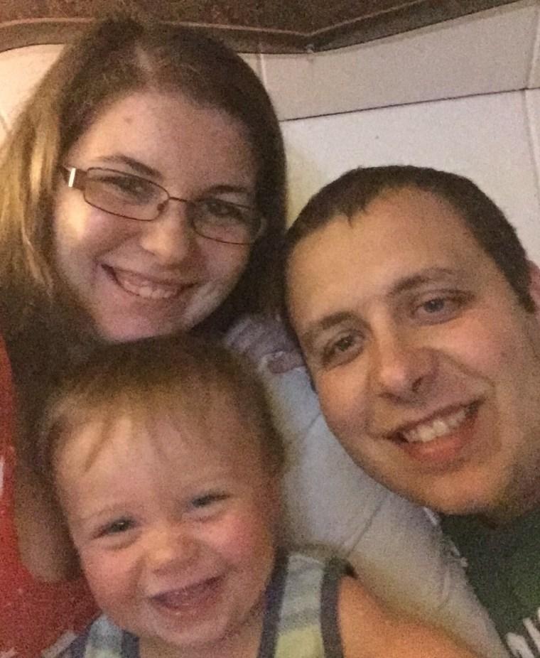Nathan Lambert with his parents, Kelsey Higgins and Jordan Lambert.