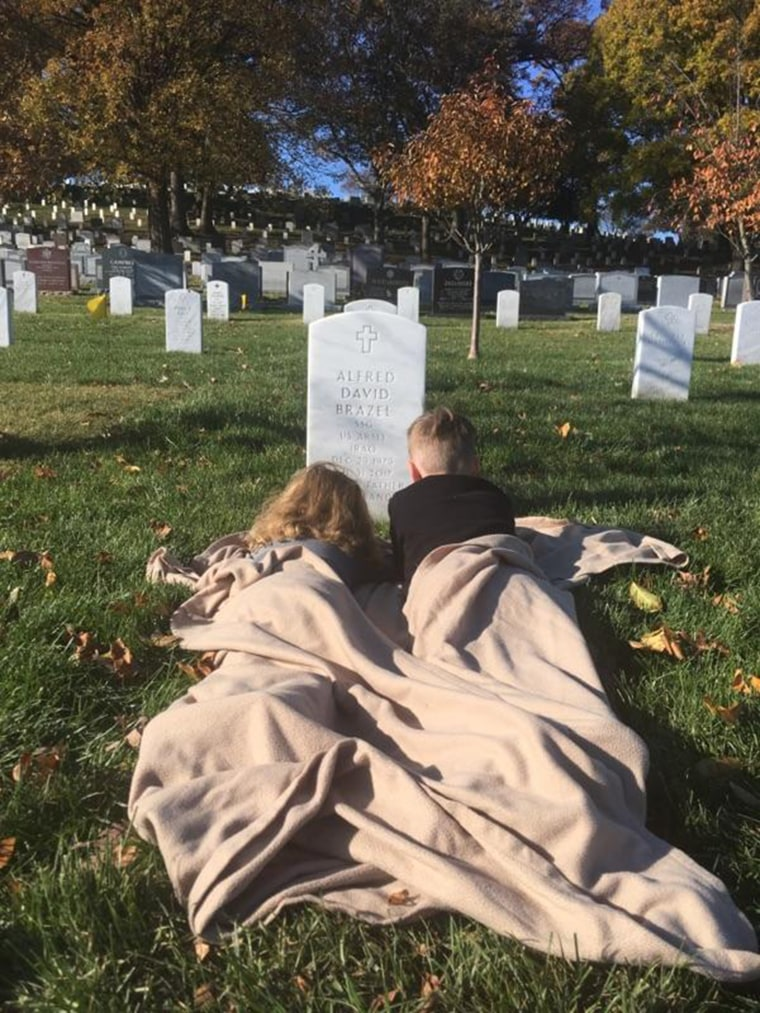 Brothers Mylan and Mason Brazel visited the grave of their father, Staff Sgt. Alfred Brazel, in a touching scene at Arlington National Cemetery for the first time since his death from cancer at 37 in July.