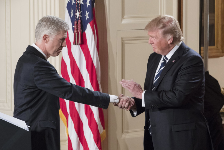 Image: Trump shakes hands with Neil Gorsuch after announcing him as his Supreme Court nominee
