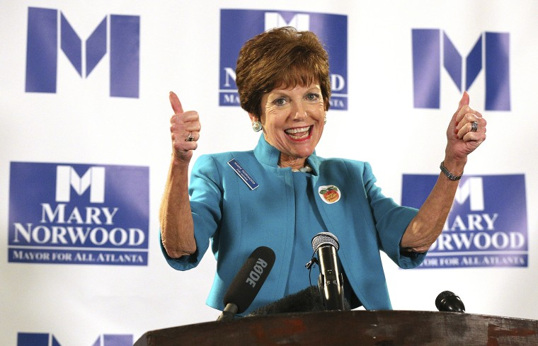 Image: Mayoral candidate Mary Norwood gives supporters a double thumbs up in Atlanta