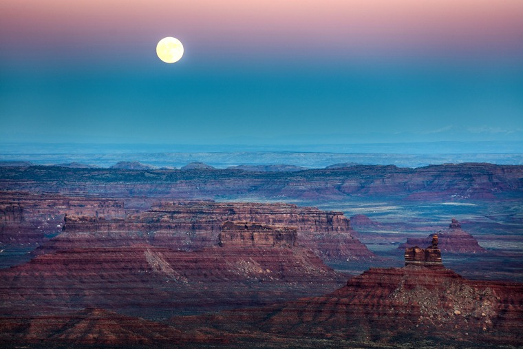 Image: A nearly-full 'supermoon' rises at dusk above the Valley of the Gods in Bears Ears National Monument near Mexican Hat