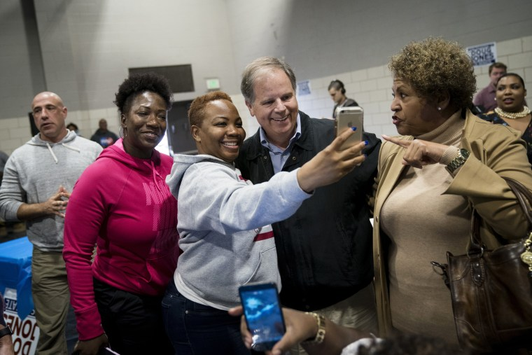 Image: Doug Jones takes photos with supporters