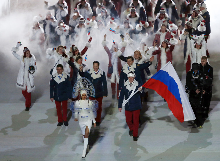 Image: The Russian delegation walks into the Opening Ceremony of the Sochi Winter Olympics