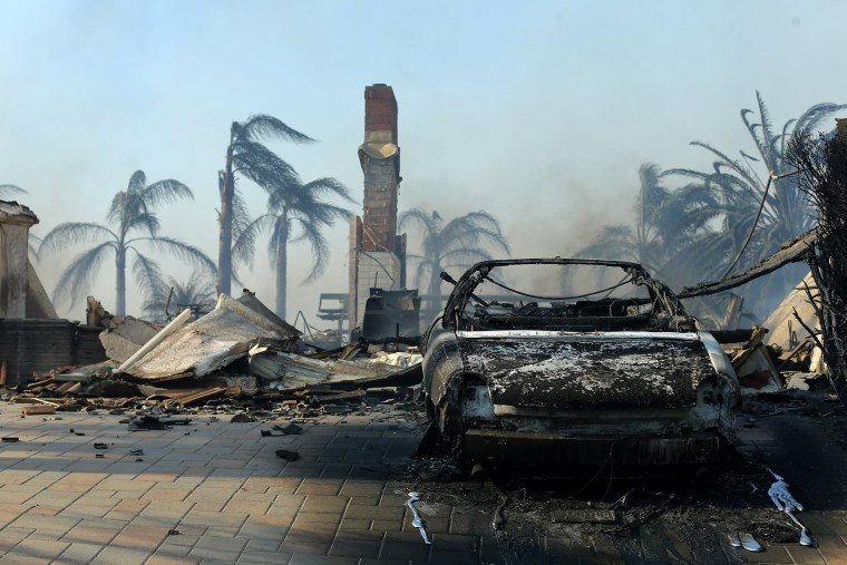Image: Remains of a home are seen after wind-driven wildfire in Ventura, California