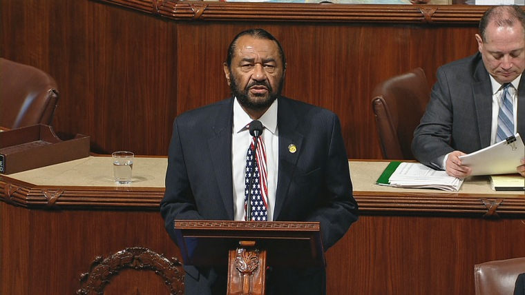 Image: Rep. Al Green, D-Texas, presents impeachment papers against President Donald Trump on the House Floor on Dec. 6, 2017.