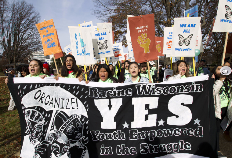 Image: Demonstrators march during an immigration rally in support of the Deferred Action for Childhood Arrivals
