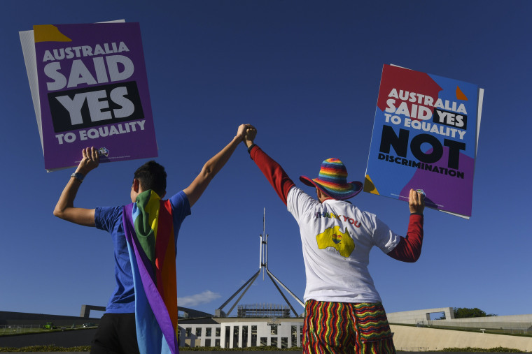 Image: Same-sex marriage campaigners in equality rally outside Parliament House in Canberra