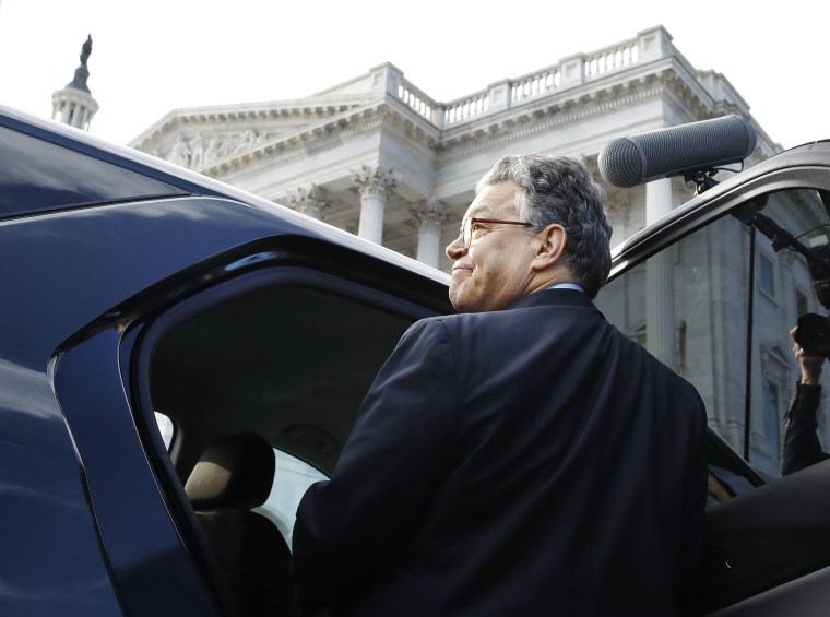 Image: Sen. Al Franken, D-Minn., leaves the Capitol after speaking on the Senate floor