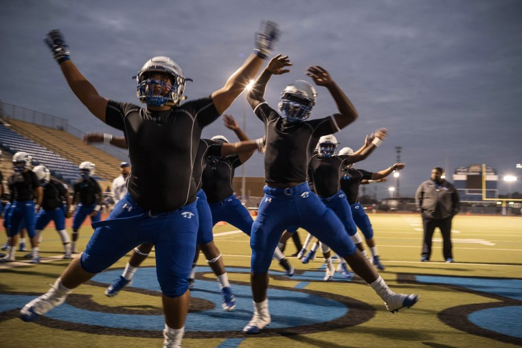 Image: The C.E. King Panthers warm up before the game