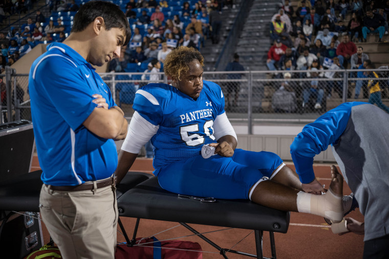 Image: C.E. King's Rashad Wright is treated for an injury during the game
