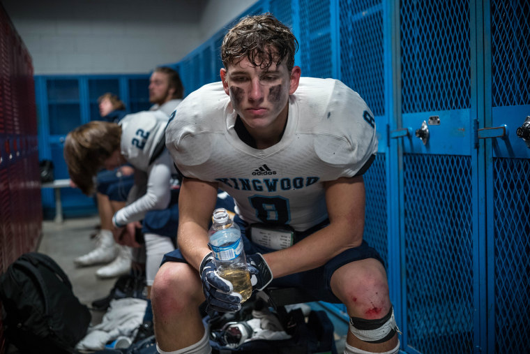 Image: Kingwood's Nolan Powell pauses in the locker room at halftime