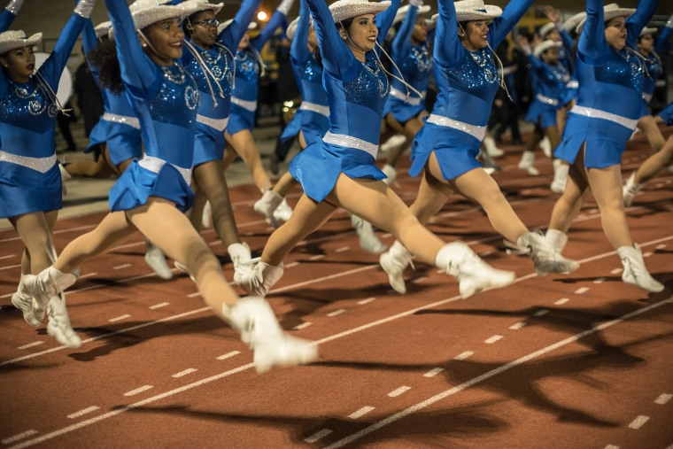 Image: The King drill team perfom during halftime.