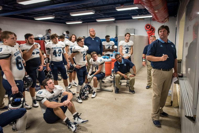 Image: Kingwood's head coach Barry Campbell addresses his team at halftime