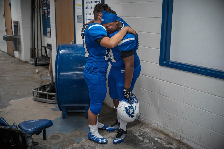 Image: C.E. King players comfort each other after their loss to Kingwood