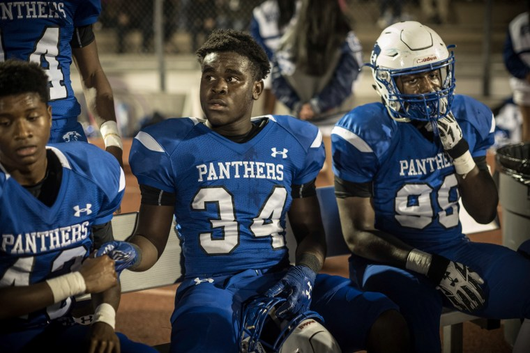 C.E. King's Roderick Crumedy, center, gets support from a teammate on the sidelines during the game with Kingwood.