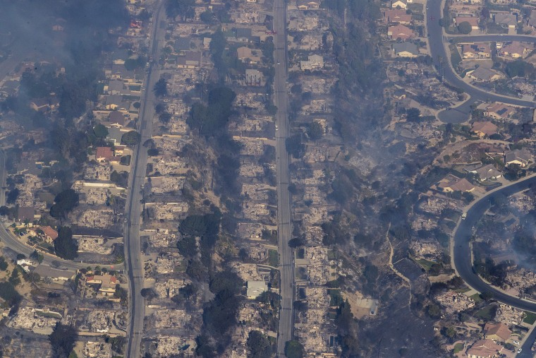 Image: Dozens of homes are destroyed in a neighborhood in view of the Thomas fire from helicopter in Ventura County, California, on Dec. 5, 2017.