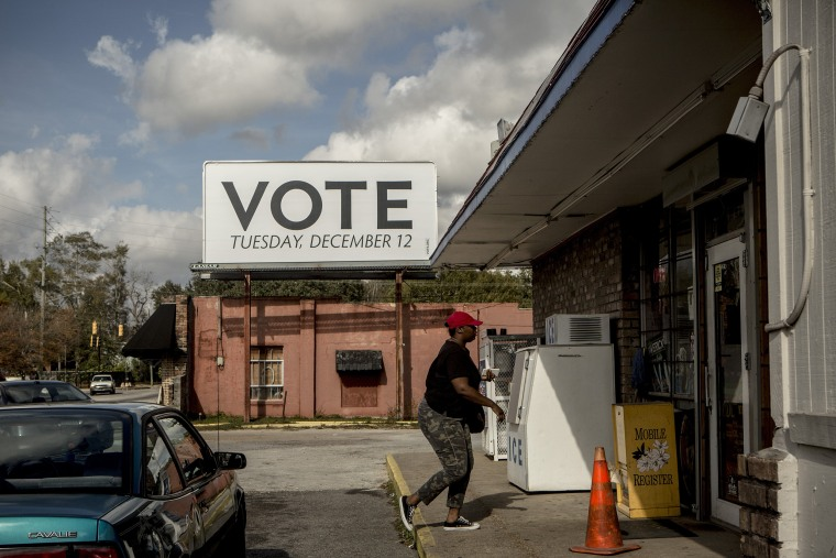 Image: A sign posted up by Vote.org, a non-partisan organization aiming to increase voter turnout and engagement, stands on Florida Street in Mobile, Alabama on Dec. 5, 2017.