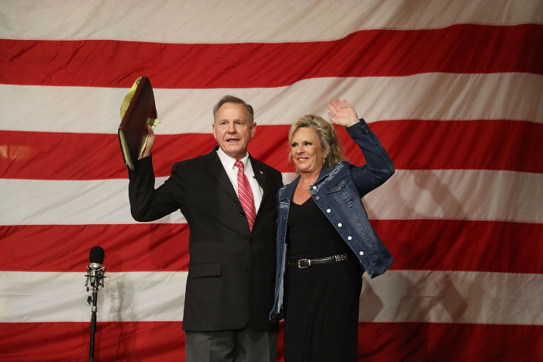 Image: Republican Senatorial candidate Roy Moore stands with his wife Kayla Moore during a campaign event at Oak Hollow Farm on Dec. 5, 2017 in Fairhope, Alabama. Mr.
