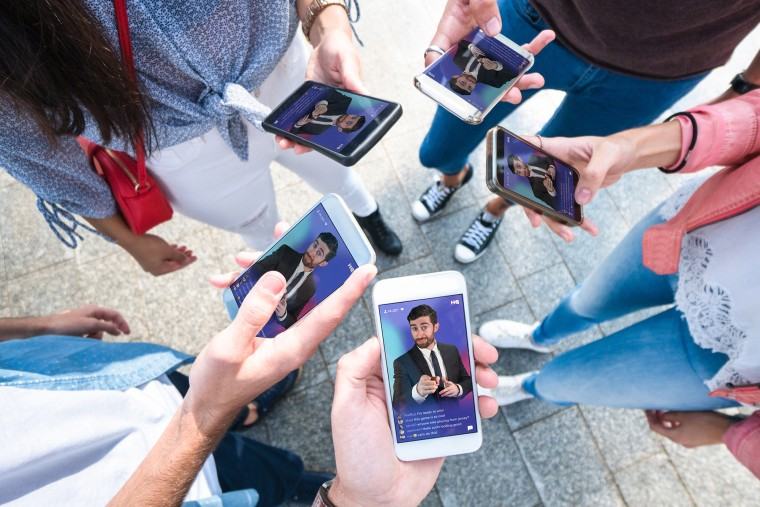 Image: A group of people playing HQ Trivia.