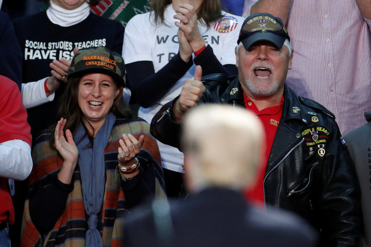 Image: People cheer for U.S. President Donald Trump as he speaks at a rally in Pensacola, Florida