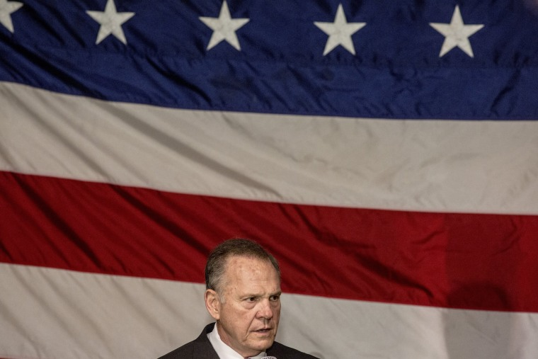Image: Moore speaks at a campaign rally.