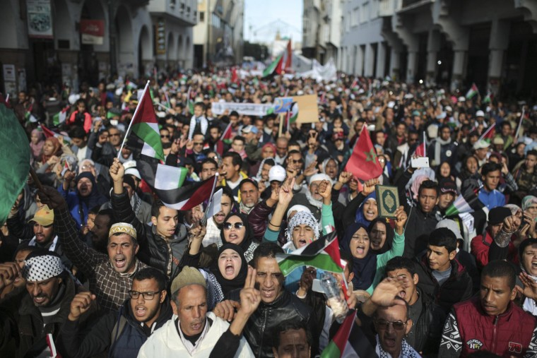 Image: People take part in a rally against U.S. President Donald Trump's decision to recognise Jerusalem as the capital of Israel, in Rabat,