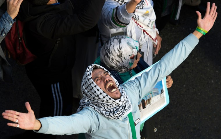 Image: A protester chants slogans against the United States and Israel