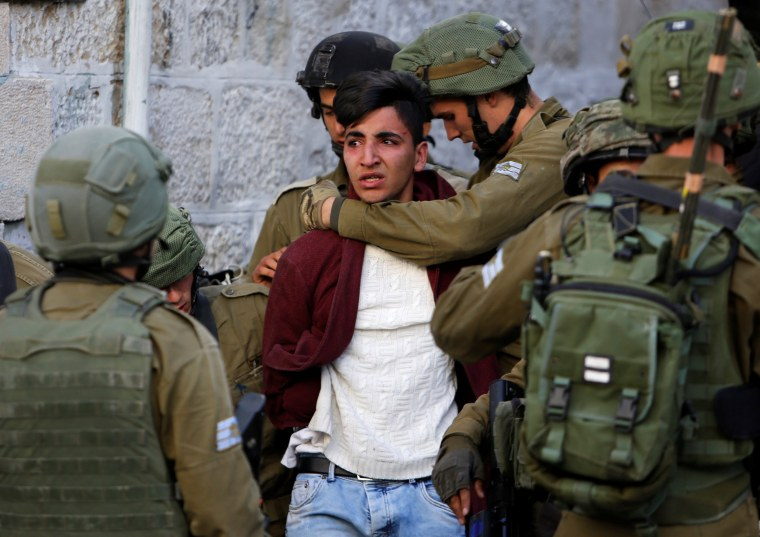 Image: Israeli soldiers detain a Palestinian during clashes at a protest against U.S. President Donald Trump's decision to recognize Jerusalem as the capital of Israel, in the West Bank city of Hebron