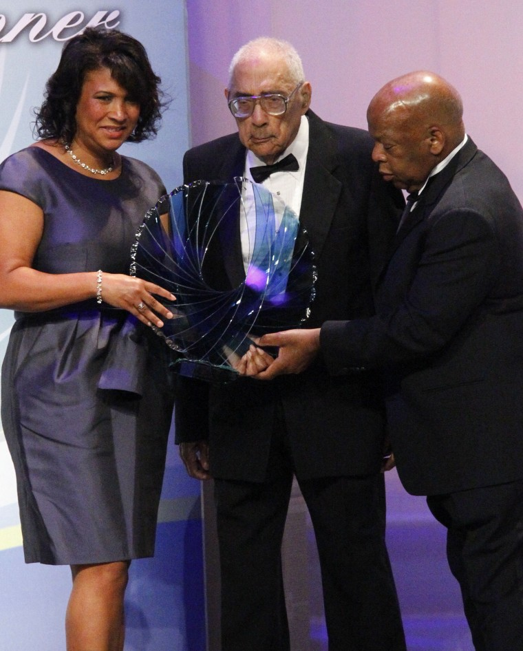 Image: Journalist Simeon Booker is presented with a Phoenix Award