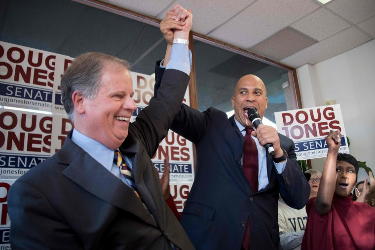 Image: Sen. Cory Booker raises Democratic Senatorial candidate Doug Jones' arm
