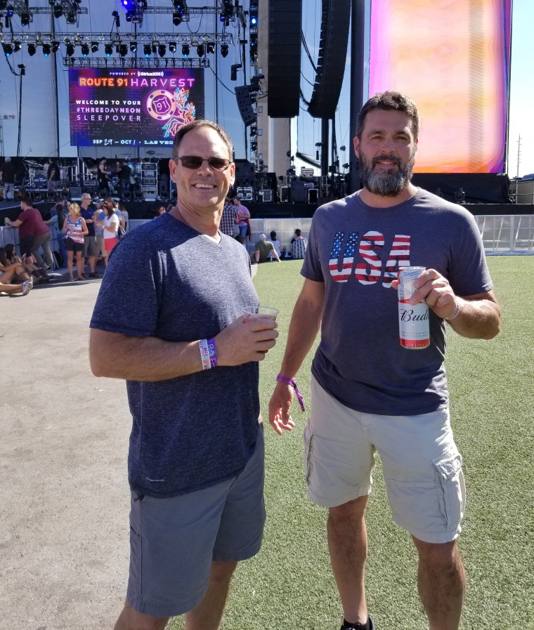 Mike Cronk, right, and Rob McIntosh at the Harvest 91 Festival in Las Vegas in October, where a gunman killed 58 people. McIntosh was among the more than 500 people injured.