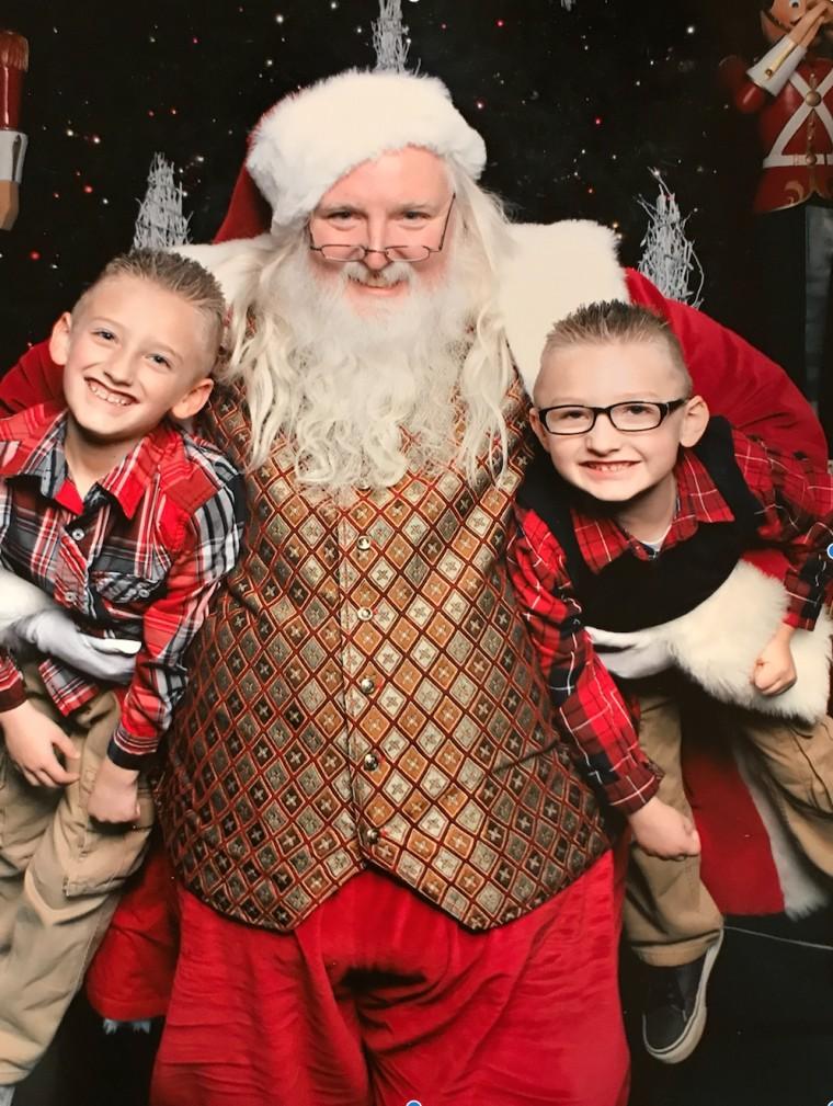Alyssa Kitchenman's sons, Aiden, 9, and Landen, 7, with Santa Scott.