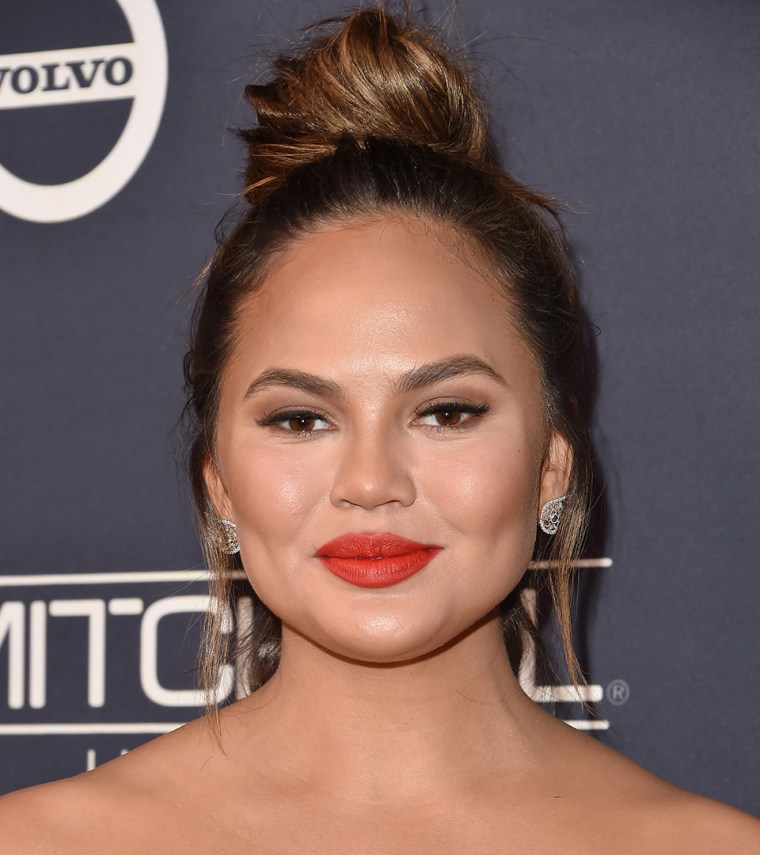 Chrissy Teigen topknot hair photo