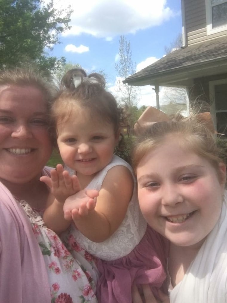 """""""These kiddos are such blessings to us all, and we are happy to be able to share a our joy and some laughs,"""" said Tana Benson, here with daughters Teegan, 2, and Taylor, 11."""