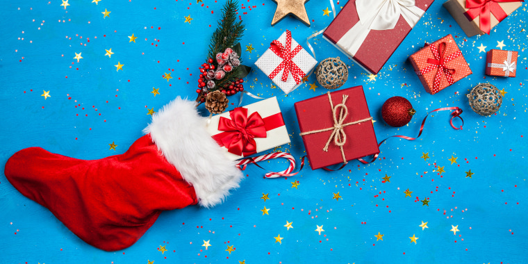 Christmas presents flowing out of Santa's stocking; Shutterstock ID 749388049; Purchase Order: -
