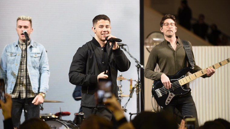 Nick Jonas celebrates the holidays at the Chase Pay Village