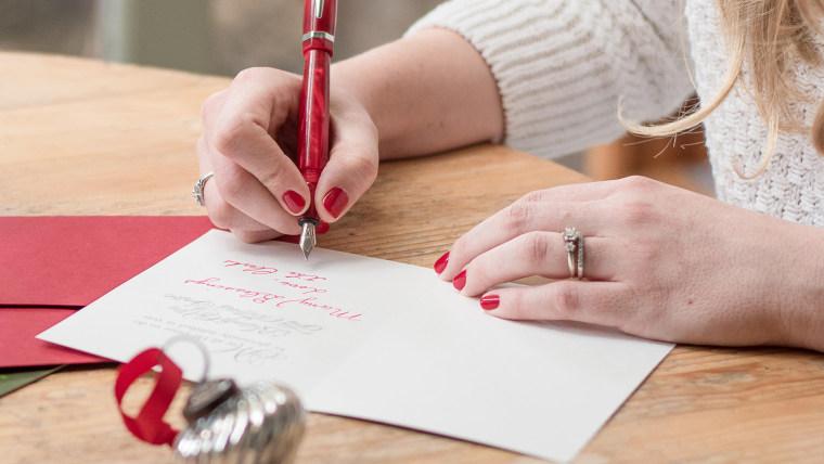Woman writes Christmas cards