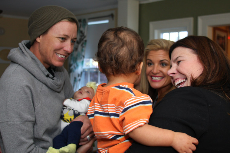 Doyle and wife, Abby Wambach, visit with residents of Hope on Haven Hill.
