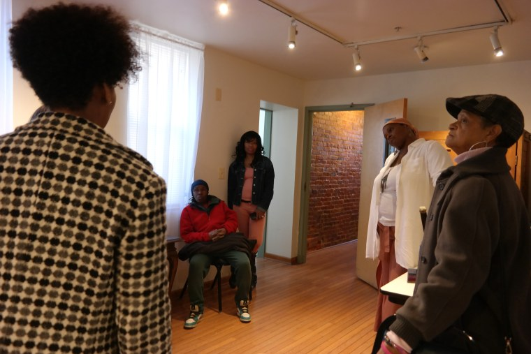 Residents of Martha's Place talk with Dr. Joy Knight Lanier.