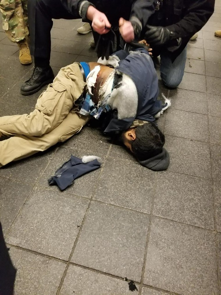 Image: Police take down Akayed Ullah, a 27-year-old Bangladeshi man suspecting of setting off a bomb at New York City's Port Authority Bus Terminal,on a subway platform between Times Square and Port Authority on Dec. 11, 2017.
