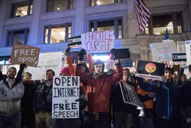 Image: Protesters gather on Bolyston Street in front of a Verizon store during a Net neutrality rally on Dec. 7, 2017 in Boston, Massachusetts.