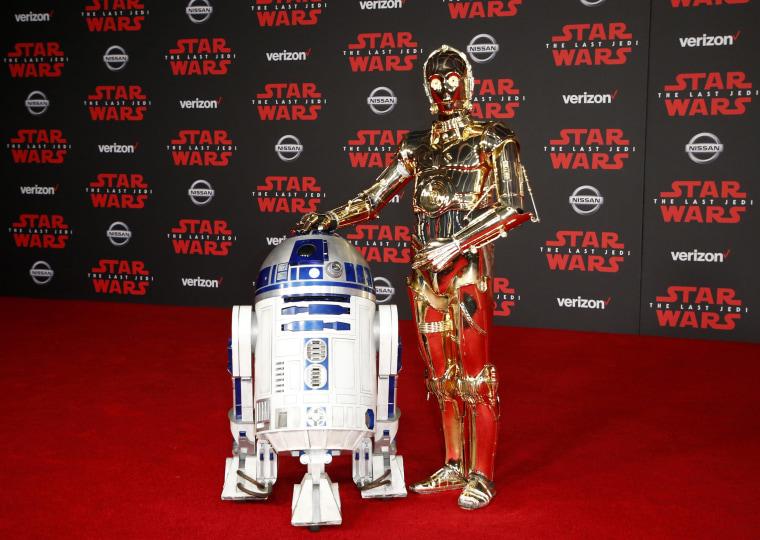 "Image: R2-D2, left, and C-3PO walk the red carpet at the World Premiere of ""Star Wars: The Last Jedi"""