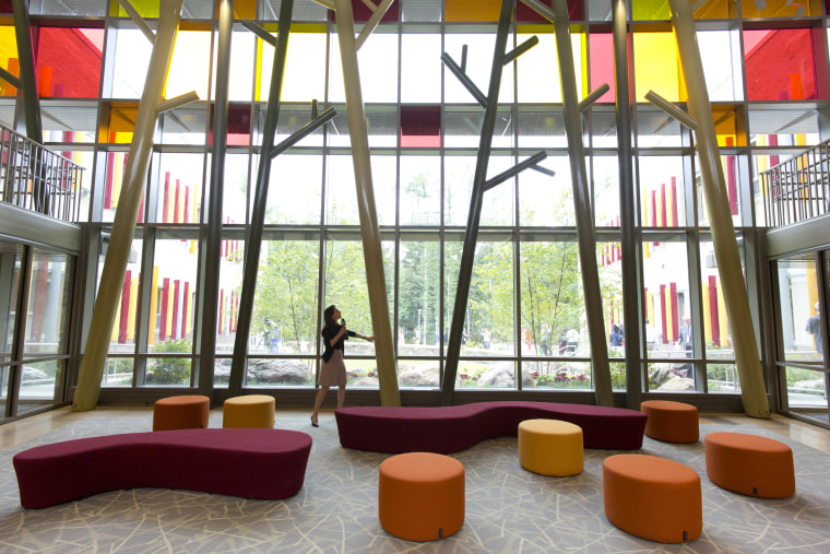 A visitor admires the lobby of the new Sandy Hook Elementary School during a media open house.