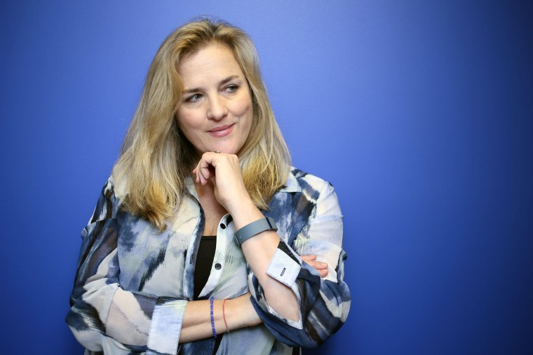 Image: Journalist Natasha Stoynoff poses at the Simon and Schuster offices