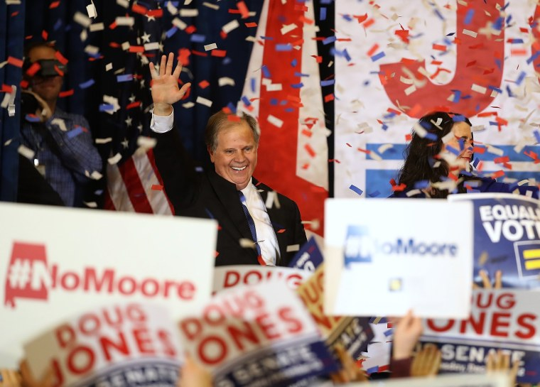 Image: Doug Jones greets supporters during his election night gathering