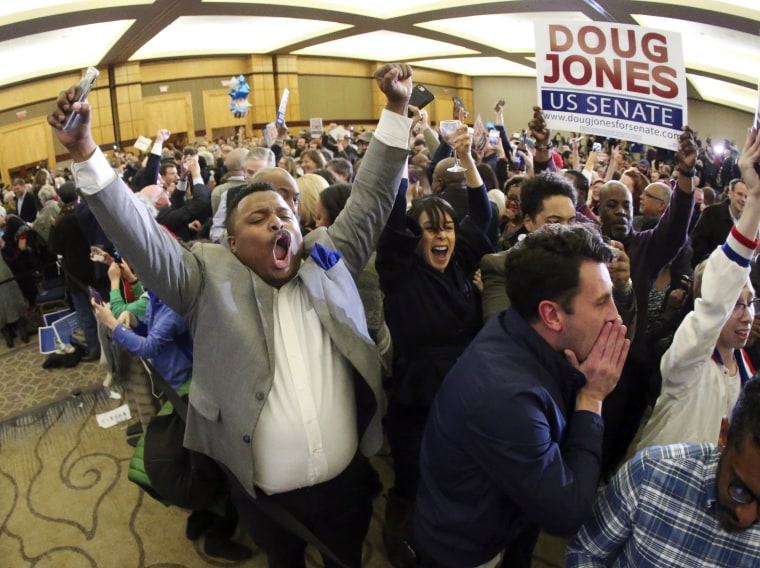 Image: Supporters of Doug Jones erupt is celebration during an election-night watch party