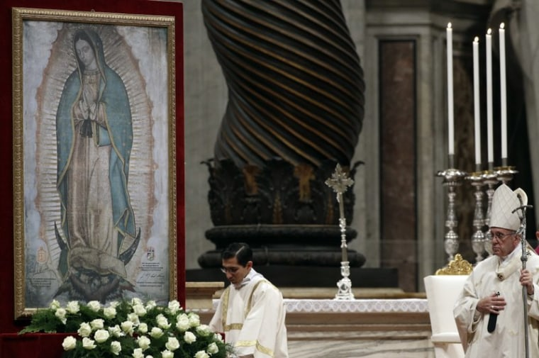 Pope Francis watches a painting depicting the Virgin of Guadalupe as he celebrates Mass at the Vatican,Tuesday, Dec. 12, 2017.