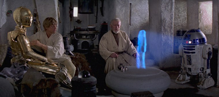 "Image: R2-D2 plays Leia's message to Obi Wan in ""Star Wars: A New Hope"""